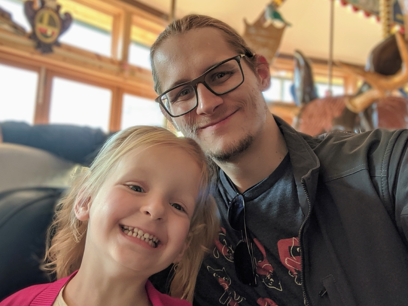 Sloan and Nicholas smile on the Carousel of Happiness in Nederland, Colorado.